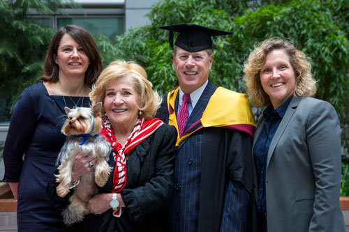 Vernon Hill celebrates his Honorary Visiting Professorship with wife Shirley, pet dog Duffy flanked by Dr Sionade Robinson and Professor Marianne Lewis of Cass Business School'