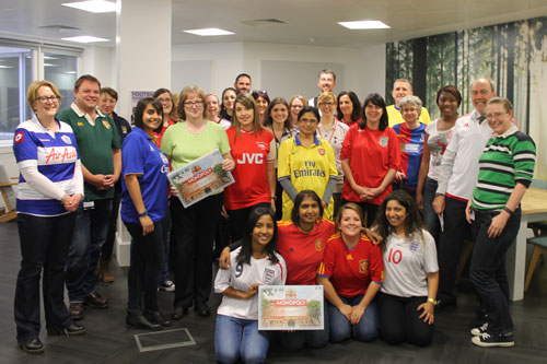 City University London staff in football shirts with City University Monopoly games