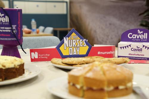 International Nurses Day 12 May sign amongst cakes