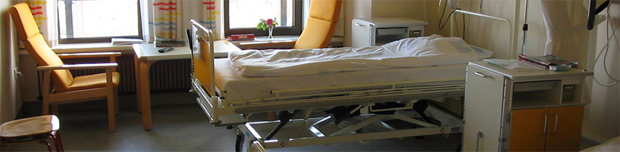 A bed in a hospital ward