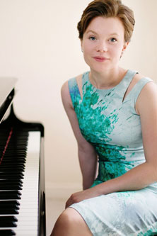 Clare Hammond sitting at a piano