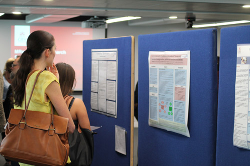 Woman looks at poster at the MRes clinical research symposium