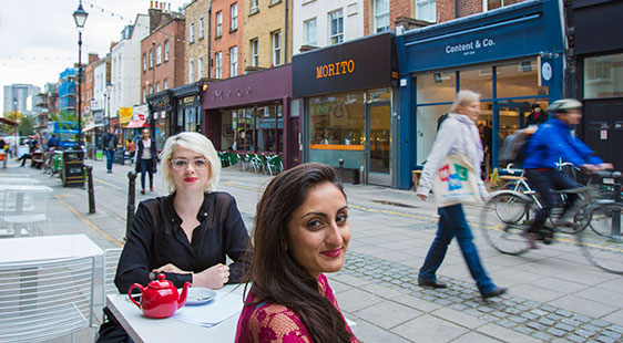 Two female City Student's Union officers in Exmouth Market in Clerkenwell London