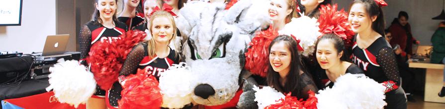 TeamCity wolf mascot with cheerleaders