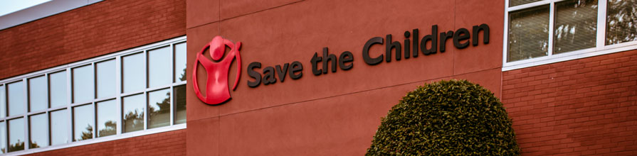 Save The Children logo on the side of an office building