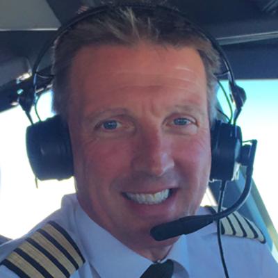 Barry Waldron wearing aviation headset