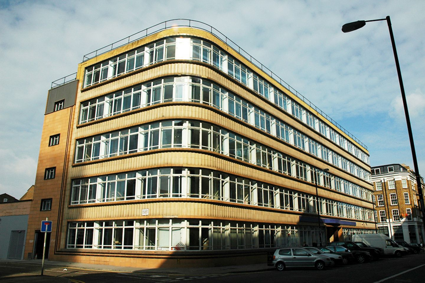 External view of Willen House, showing it's 1940's Bauhaus design with curved corners and wrapping windows.